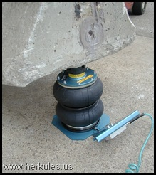Herkules Air Jack Lifting Cement Block